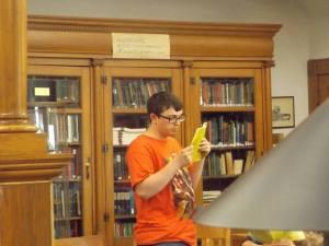 Micah Bauman reads his poem.