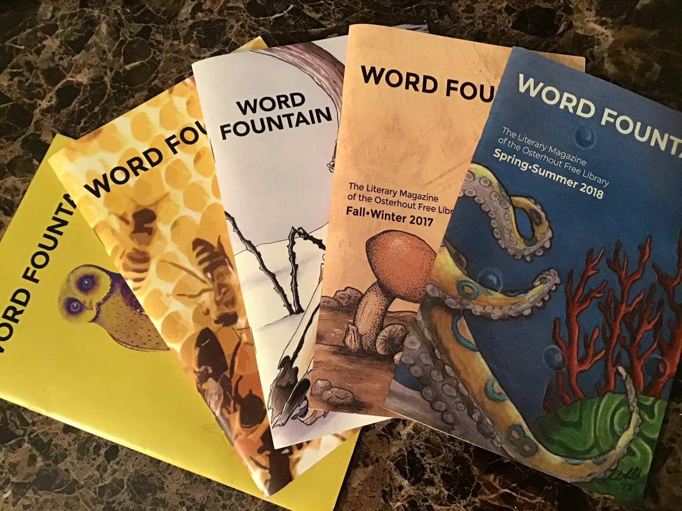 Various covers of Word Fountain Magazine